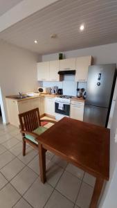 A cozinha ou cozinha compacta de APPARTEMENT COSY VUE MER