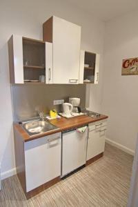 Küche/Küchenzeile in der Unterkunft Kapitänshaus Lassen - Zimmer Amistad