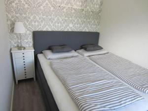 Ein Bett oder Betten in einem Zimmer der Unterkunft Ferienwohnung Oben