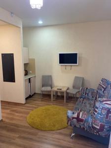 Телевизор и/или развлекательный центр в Hotel Home