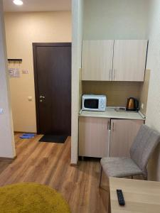 Кухня или мини-кухня в Hotel Home