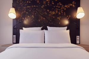 Un ou plusieurs lits dans un hébergement de l'établissement Mercure Paris la Défense Grande Arche
