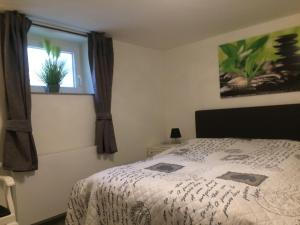 Ein Bett oder Betten in einem Zimmer der Unterkunft Residenz am Trammer See