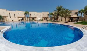 The swimming pool at or near Simaisma A Murwab Resort