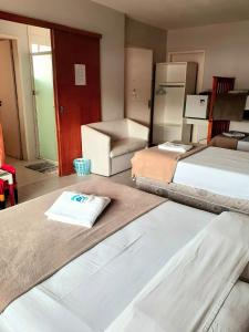 A bed or beds in a room at Pousada Terra Sul