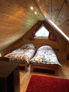 Ein Bett oder Betten in einem Zimmer der Unterkunft Lüly