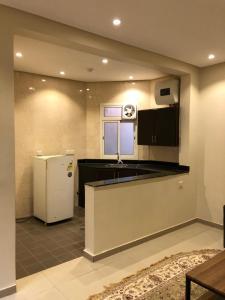 A cozinha ou cozinha compacta de بي تو للوحدات الفندقية