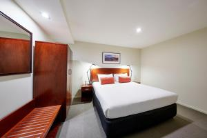 A bed or beds in a room at RACV Hobart Hotel