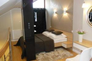 Łóżko lub łóżka w pokoju w obiekcie Apartament Platinum Dwupiętrowy z Garażem