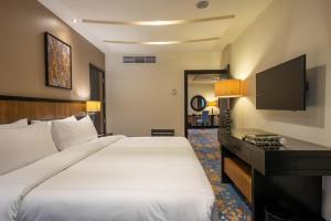 Cama ou camas em um quarto em Al Ghufran Safwah Hotel Makkah
