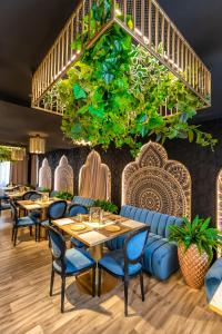 A restaurant or other place to eat at Alex&George Boutique Hotel