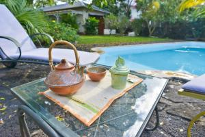 The swimming pool at or near Tree Lodge Mauritius