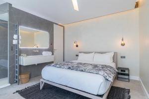 Un ou plusieurs lits dans un hébergement de l'établissement Le Dortoir Multi Storey Luxury Suites