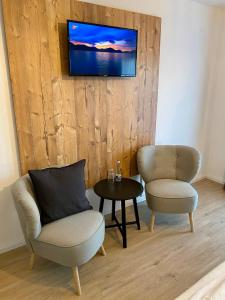 Ein Sitzbereich in der Unterkunft Landgasthaus Löwen mit Gästehaus