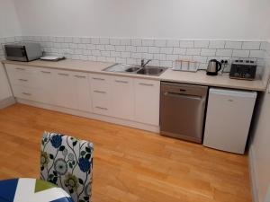 A kitchen or kitchenette at The Old Dairy Factory