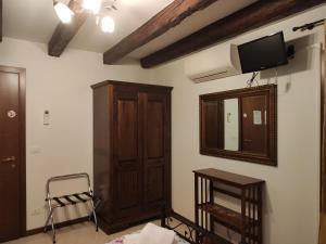 Телевизор и/или развлекательный центр в Sweet Venice - locazione turistica