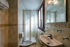 Een badkamer bij Hotel Al Vagon