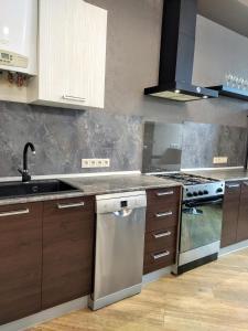 A kitchen or kitchenette at Стильная квартира у самого моря