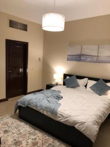Cama ou camas em um quarto em KAEC-Coast Oasis 1