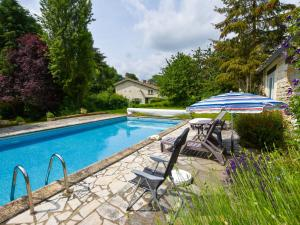 The swimming pool at or near charming cottage with a swimming pool