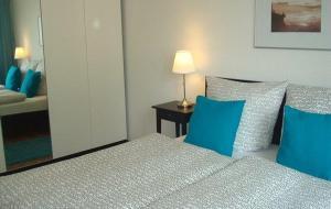 Ein Bett oder Betten in einem Zimmer der Unterkunft Ferienwohnung Reiche