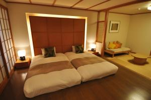 A bed or beds in a room at Dogo Prince Hotel
