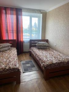A bed or beds in a room at Hotel Yuvileyny