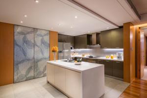 A kitchen or kitchenette at Ascott Raffles City Beijing