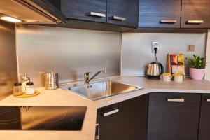 A kitchen or kitchenette at Royal Route Residence Lesser Town