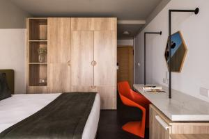 Кровать или кровати в номере Cavalieri Art Hotel