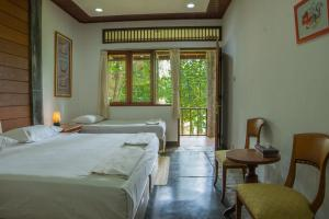 A bed or beds in a room at Griya Dunamis by SABDA