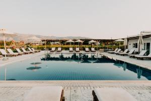 The swimming pool at or near Sails on Kos Ecolux Tented Village