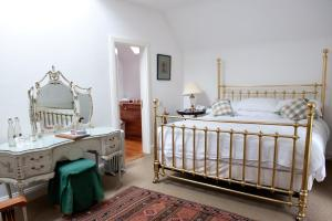 A bed or beds in a room at Ardanaiseig Hotel