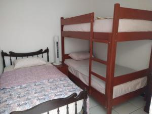 A bunk bed or bunk beds in a room at La Terracita de Máncora