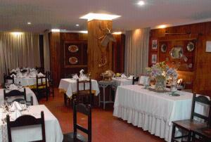 A restaurant or other place to eat at Hotel los Nogales
