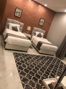 """سرير أو أسرّة في غرفة في Tamara Beach Resort, Al Khobar Half Moon Bay-""""Families Only"""""""