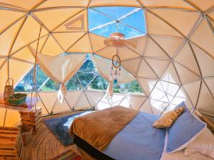 A bed or beds in a room at Alma de Campo Glamping - Laguna de Suesca