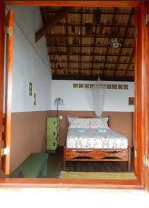 A bed or beds in a room at Pousada Mar de Sonhos
