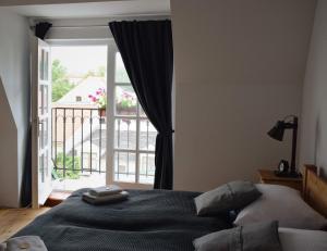 Ein Bett oder Betten in einem Zimmer der Unterkunft Penzion U Johanky