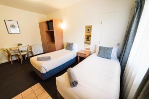 Кровать или кровати в номере Barclay On View