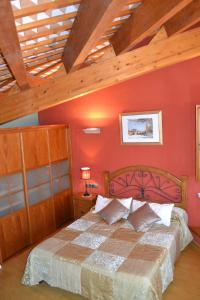 Llit o llits en una habitació de Ca la Trini Picotxa
