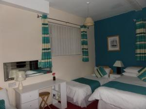 A bed or beds in a room at The Grays