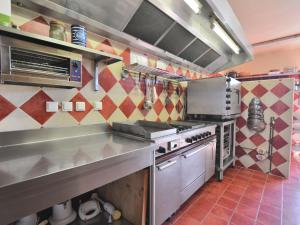 A kitchen or kitchenette at Superb Villa with Private Heated Pool close to Carcassonne