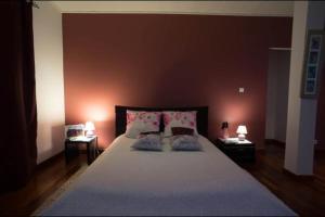 Un ou plusieurs lits dans un hébergement de l'établissement Villa Bel'Ombre - Chambres d'hôte