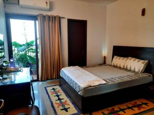 A bed or beds in a room at Sublime Home stay