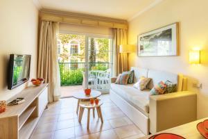 A seating area at VIVA Cala Mesquida Resort & Spa