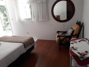 A bed or beds in a room at Lar do Vale - Vinhedos