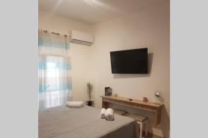 A television and/or entertainment center at Modern elegant apartment next to Mon Repo