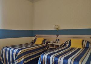 A bed or beds in a room at Hotel Torre Di Pratolungo