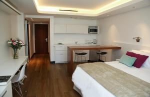 A kitchen or kitchenette at Ilum Experience Home